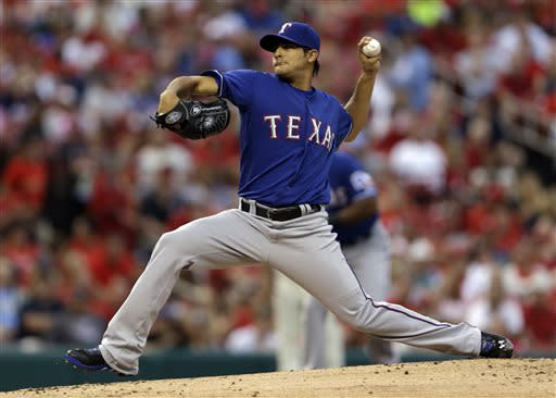 Texas Rangers relief pitcher Martin Perez throws during the first inning of a baseball game against the St. Louis Cardinals on Saturday, June 22, 2013, in St. Louis. (AP Photo/Jeff Roberson)