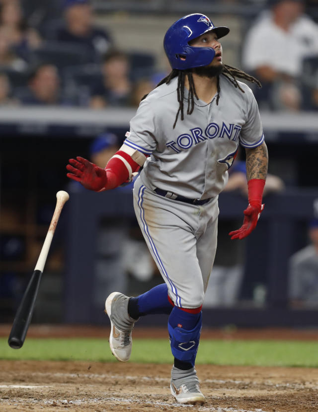 Toronto Blue Jays' Freddy Galvis watches his grand slam during the eighth inning of a baseball game against the New York Yankees, Monday, June 24, 2019, in New York. (AP Photo/Kathy Willens)