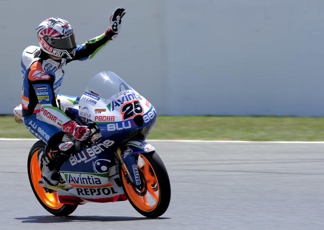 Blusens Avintia's Spanish Maverick Vinales celebrates after taking the pole position at the Catalunya racetrack in Montmelo, near Barcelona, on June 2, 2012, during the Moto3 qualifying session of the Catalunya Moto GP Grand Prix. AFP PHOTO / JOSEP LAGOJOSEP LAGO/AFP/GettyImages