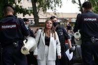 Policemen detain a woman during a picket in support of former journalist Ivan Safronov in Moscow