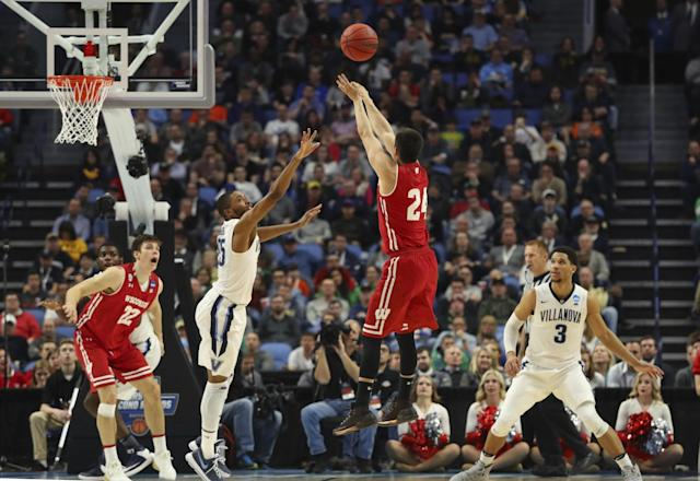 <p>Wisconsin guard Bronson Koenig (24) takes a three-point shot against Villanova guard Mikal Bridges (25) during the second half of a second-round men's college basketball game in the NCAA Tournament, Saturday, March 18, 2017, in Buffalo, N.Y. Wisconsin won, 65-62. (AP Photo/Bill Wippert) </p>