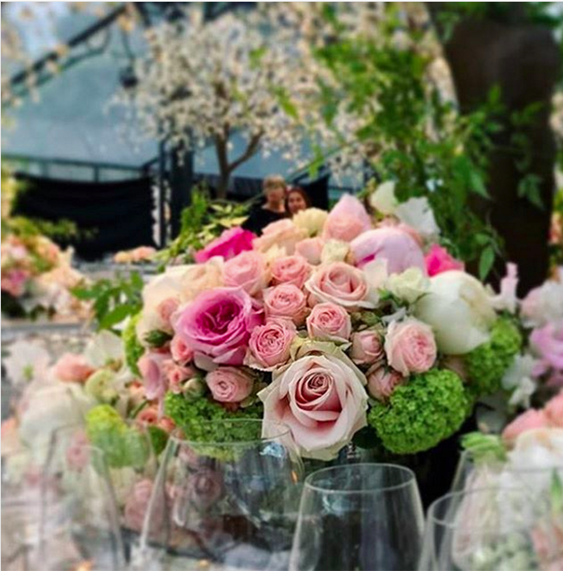 Pretty rose centerpieces were places on each table. Photo: Instagram