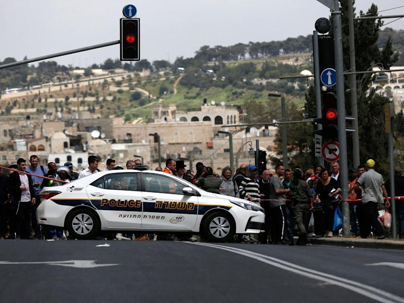A crowd formed at the scene of the attack. The Old City was packed with people as Jews marked Passover and Christians celebrated Easter (Getty)