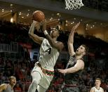 Miami guard Lonnie Walker IV, left, goes to the basket against Boston College forward Nik Popovic, right, in the second half of an NCAA college basketball game in Coral Gables, Fla., Saturday, Feb. 24, 2018. (Pedro Portal/Miami Herald via AP)