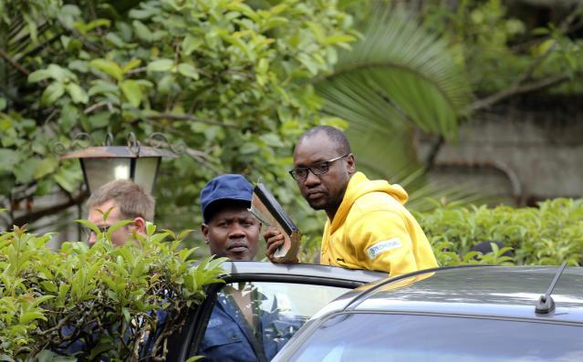 Evan Mawarire, an activist and pastor who helped mobilize people to protest against the hike in fuel prices, is arrested at his residence in Harare, Zimbabwe, Wednesday, Jan. 16, 2019. Mawarire was arrested Wednesday for allegedly inciting violence in the protests against the government's increase in fuel prices. (AP Photo/Tsvangirayi Mukwazhi)