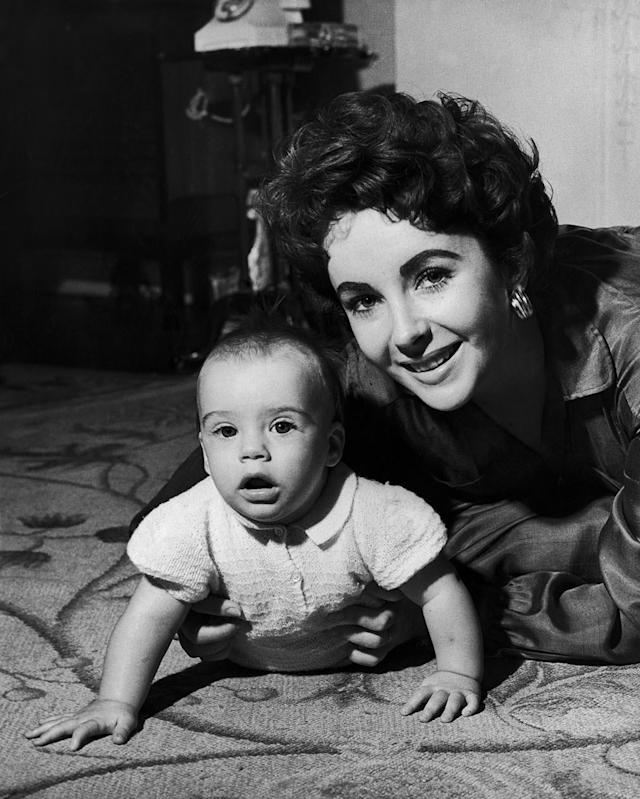 <p>Elizabeth Taylor with her son Michael Wilding Jnr. She became a mother at 21. (Photo by Keystone/Getty Images) </p>