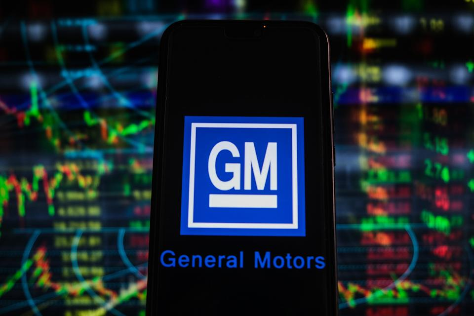 POLAND - 2021/04/26: In this photo illustration a General Motors logo seen displayed on a smartphone with stock market percentages in the background. (Photo Illustration by Omar Marques/SOPA Images/LightRocket via Getty Images)