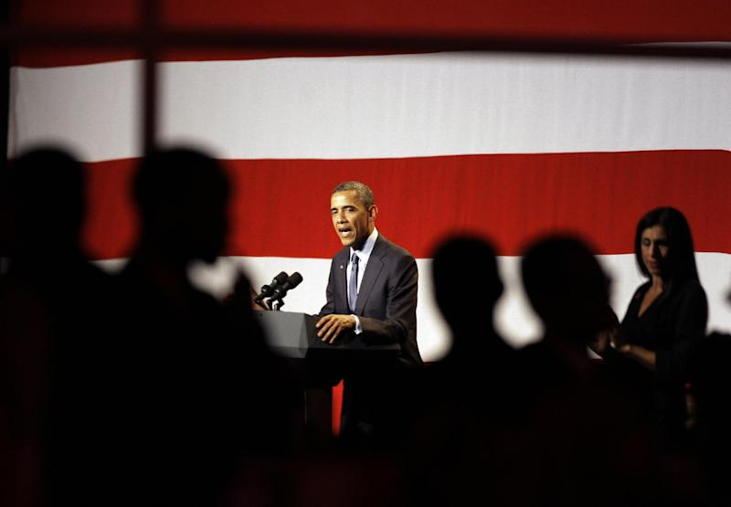 President Barack Obama, reflected in a mirror at the side of the ballroom, so his image is reversed, speaks at a campaign fundraiser sponsored by the Lesbian, gay, bisexual and transgender community, at the Beverly Wilshire Hotel in Beverly Hills, Calif., Wednesday, June 6, 2012. (AP Photo/Reed Saxon)