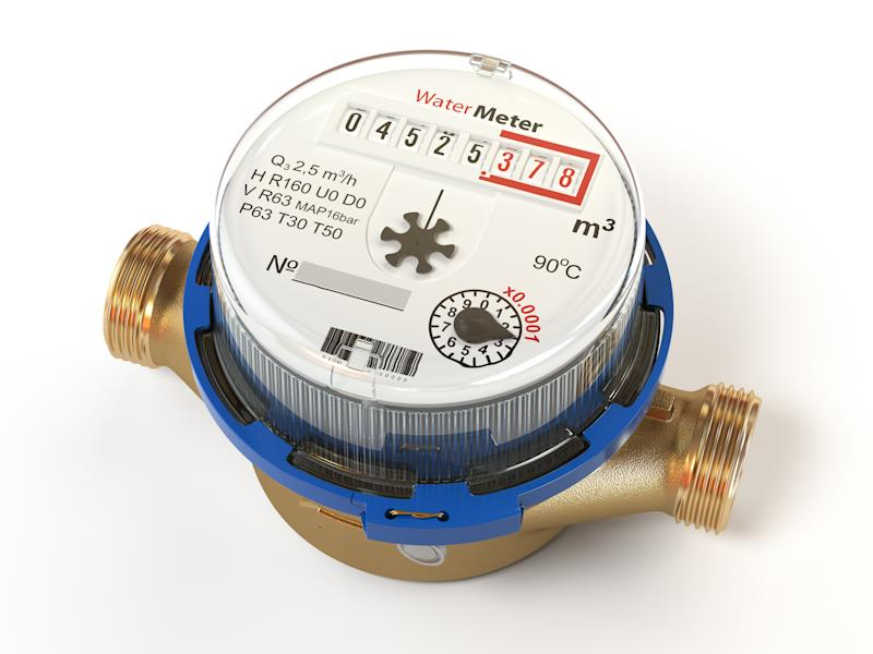 A water meter with copper pipe fittings.