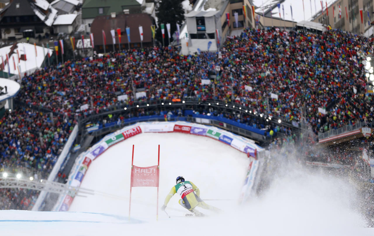 Aksel Lund Svindal of Norway skis during the second run of the men's Giant Slalom race at the World Alpine Skiing Championships in Schladming February 15, 2013.   REUTERS/Dominic Ebenbichler (AUSTRIA  - Tags: SPORT SKIING TPX IMAGES OF THE DAY) - RTR3DU2H
