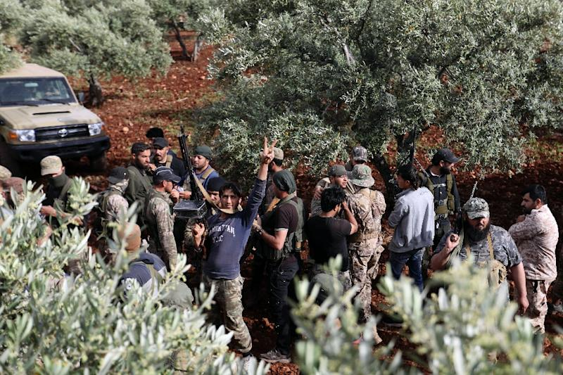 Syrian rebels gather in a field in the northern countryside of Hama province during clashes with regime forces (AFP Photo/OMAR HAJ KADOUR)
