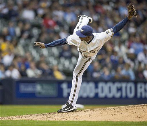 Milwaukee Brewers' Alfredo Figaro pitches to an Arizona Diamondbacks batter during the seventh inning of a baseball game Saturday, April 6, 2013, in Milwaukee. (AP Photo/Tom Lynn)