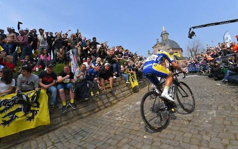 <span>Kenneth Van Rooy on the Muur</span> <span>Credit: &nbsp;Getty Images </span>
