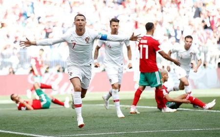 Soccer Football - World Cup - Group B - Portugal vs Morocco - Luzhniki Stadium, Moscow, Russia - June 20, 2018 Portugal's Cristiano Ronaldo celebrates scoring their first goal REUTERS/Carl Recine