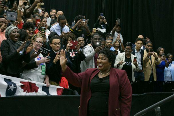 PHOTO: Georgia Democratic Gubernatorial candidate Stacey Abrams enters the arena for a campaign rally at Morehouse College with Former US President Barack Obama on Nov. 2, 2018, in Atlanta. (Jessica Mcgowan/Getty Images)
