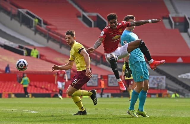 Marcus Rashford battles for the ball