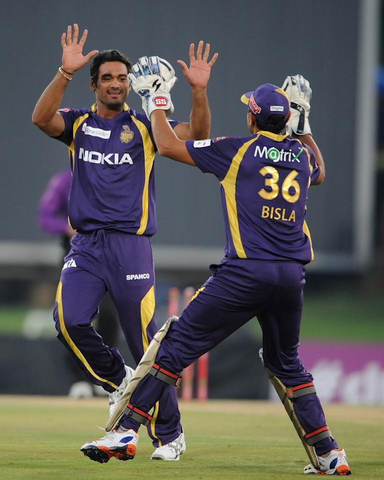PRETORIA, SOUTH AFRCA - OCTOBER 13:  Prandeep Sangwan (L) of the Knight Riders celebrates capturing the wicket of Virender Sehwag with wicketkeeper Manvinder Bisla (R) during the Karbonn Smart CLT20 Group A match between Kolkata Knight Riders (IPL) and Delhi Daredevils (IPL) at SuperSport Park on October 13, 2012 in Pretoria, South Africa.  (Photo by Lee Warren/Gallo Images/Getty Images)