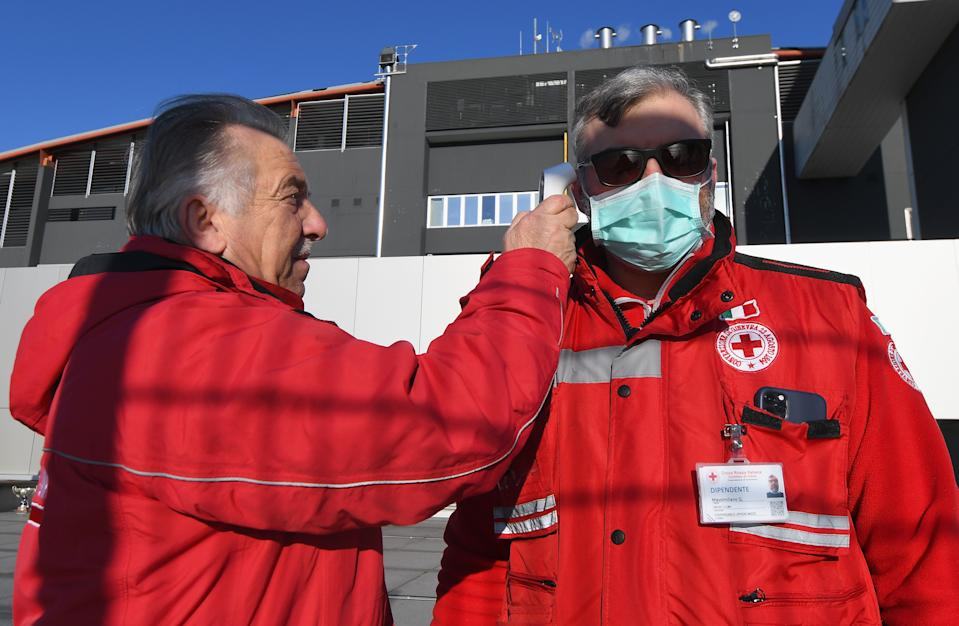 An operator performs anti-coronavirus checks before the Serie A match between Udinese Calcio and ACF Fiorentina at Stadio Friuli on March 08, 2020 in Udine, Italy. (Photo by Alessandro Sabattini/Getty Images)