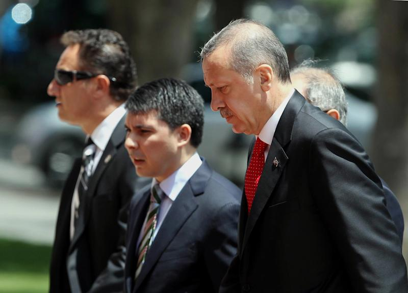 "Turkish Prime Minister Recep Tayyip Erdogan, right, arrives for a cabinet meeting in his office in Ankara, Turkey, Monday, June 25, 2012. Upon Turkey's request, NATO will hold a meeting Tuesday in Brussels over article 4 of its charter concerning Friday's incident, when a Turkish warplane was shot down by Syria. Syria's Foreign Ministry spokesman Jihad Makdissi said Monday his country has ""no hostility"" toward Turkey as tensions soar between the former allies three days after Syria shot down a Turkish plane. (AP Photo)"