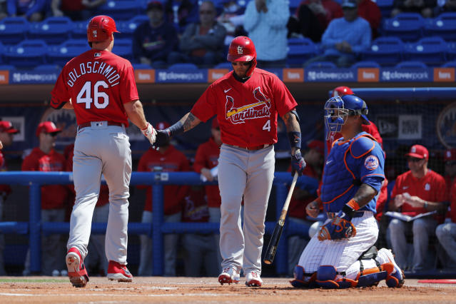 St. Louis Cardinals' Paul Goldschmidt (46) is congratulated by teammate Yadier Molina (4) after hitting a solo home run as New York Mets catcher Wilson Ramos, right, kneels at the plate during the first inning of a spring training baseball game Friday, Feb. 28, 2020, in Port St. Lucie, Fla. (AP Photo/Jeff Roberson)