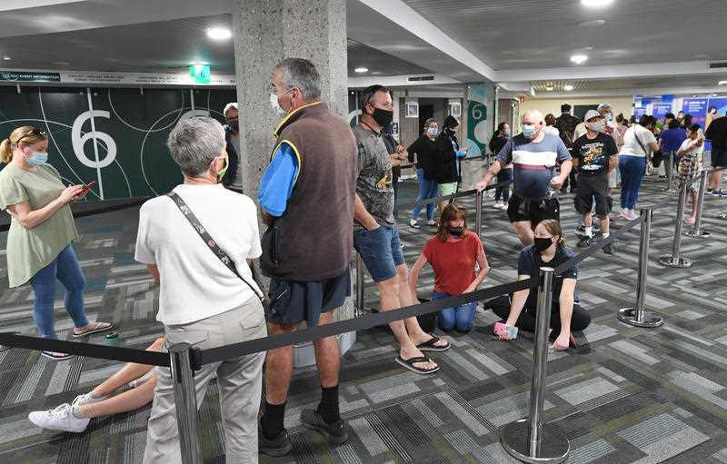 People are seen lined up to receive a vaccination for COVID-19 at the Boondall mass vaccination hub in Brisbane.