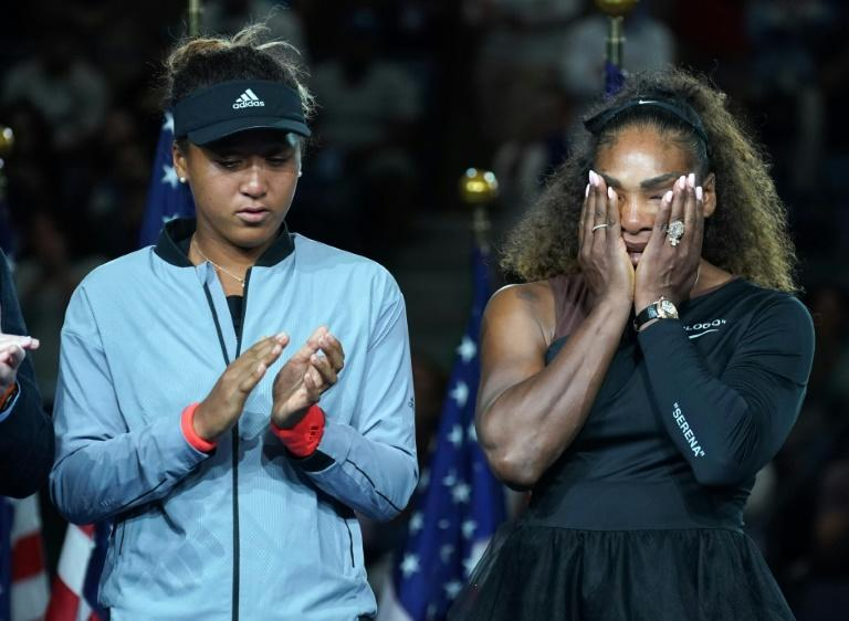 Overshadowed: Triumphant Naomi Osaka stands beside defeated Serena Williams after a chaotic end to their US Open final