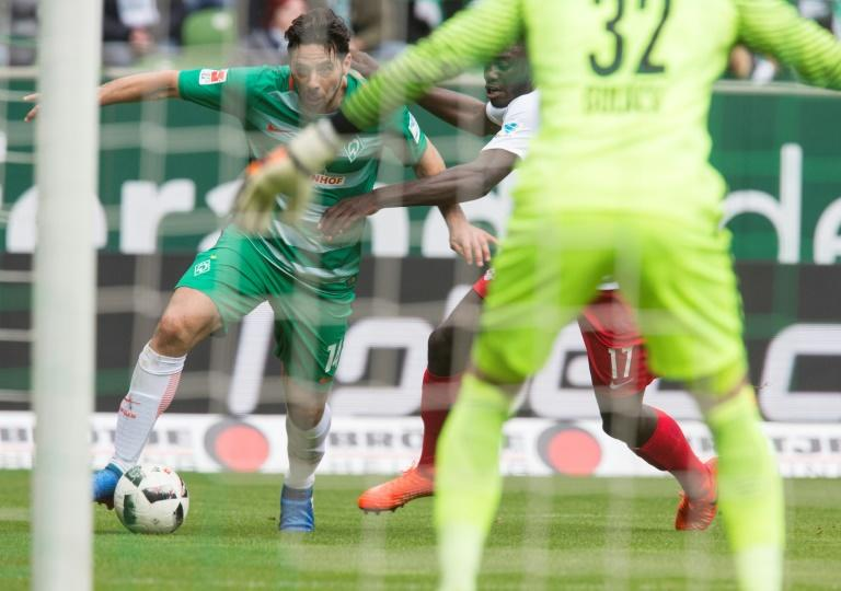 Bremen's forward Claudio Pizarro (L) and Leipzig's defender Dayot Upamecano vie for the ball during the German First division Bundesliga football match March 18, 2017