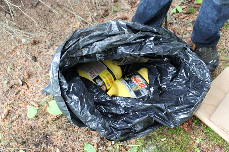 This undated photo provided by the FBI shows bottles of Drano found inside a plastic bag in Eagle River, Alaska, just north of Anchorage. The FBI says confessed Alaska serial killer Israel Keyes, who targeted people across the country, told authorities he planned to strike again in the state if he had gotten away with the murder of an 18-year-old Anchorage barista. (AP Photo/FBI)