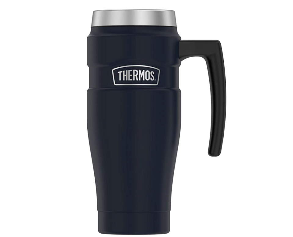 """<p><strong>THERMOS</strong></p><p>amazon.com</p><p><strong>$24.99</strong></p><p><a href=""""https://www.amazon.com/dp/B08JWMVB43?tag=syn-yahoo-20&ascsubtag=%5Bartid%7C1782.g.36865936%5Bsrc%7Cyahoo-us"""" rel=""""nofollow noopener"""" target=""""_blank"""" data-ylk=""""slk:BUY NOW"""" class=""""link rapid-noclick-resp"""">BUY NOW</a></p><p>The handle of the THERMOS travel mug allows for easy one hand lifting so you can enjoy your coffee even when your hands are full—which is probably most mornings.</p>"""