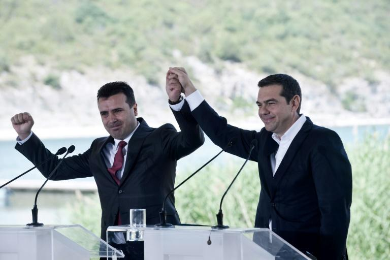 The name change was agreed on in talks between Greek Prime Minister Alexis Tsipras, seen on the right, and his Macedonian counterpart Zoran Zaev, both of whom were at the signing ceremony