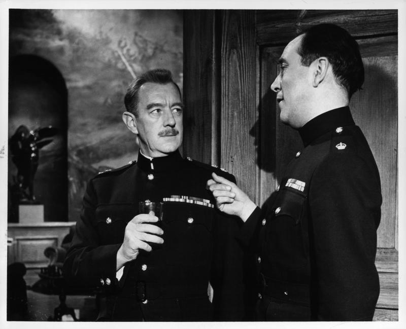 Alec Guinness listens as Dennis Price talks to him in a scene from the film 'Tunes Of Glory', 1960. (Photo by United Artists/Getty Images)