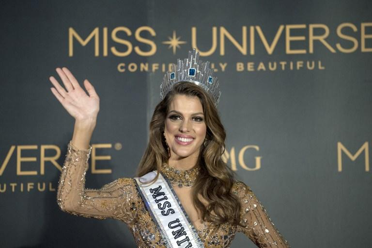 <p>The new Miss Universe Iris Mittenaere of France waves to photographers during a press conference after being crowned the winner at the Miss Universe pageant at the Mall of Asia Arena in Manila on January 30, 2017. France was crowned Miss Universe on January 30 in a glitzy spectacle free of last year's dramatic mix-up but with a dash of political controversy as finalists touched on migration and other hot-button global issues. / AFP PHOTO / NOEL CELIS </p>