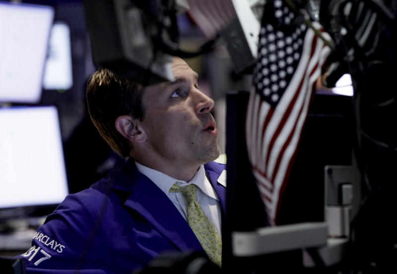 FILE-- A June 25, 2012 file photo shows Specialist Christopher Trotta working on the floor of the New York Stock. Wall Street was poised for a muted open Tuesday June 26, 2012, with both Dow futures and the broader S&P 500 futures up 0.2 percent.   A parade of grim news sent investors fleeing stocks for a third straight day on Tuesday July 24, 2012. (AP Photo/Richard Drew/file)