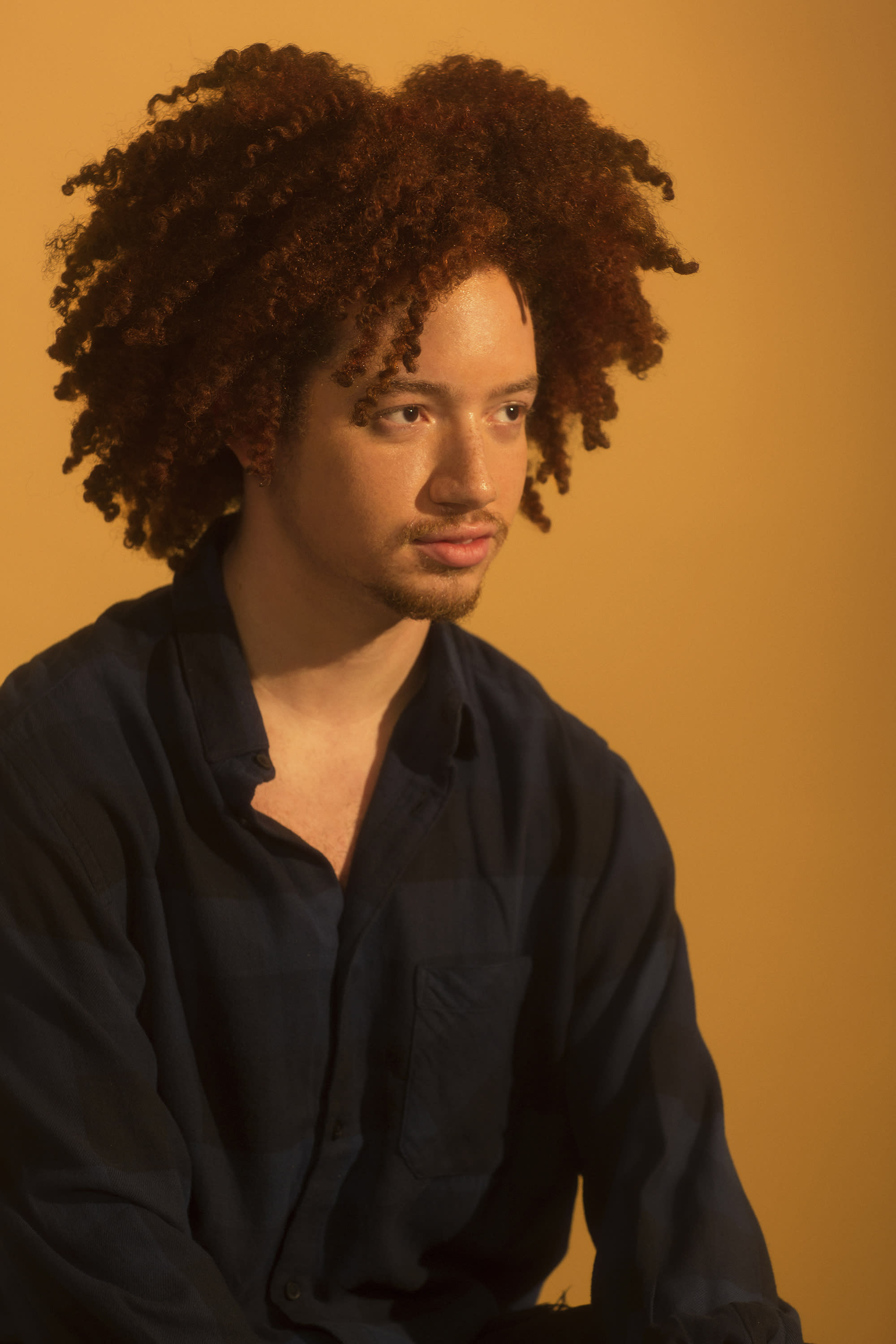 Communications student Brandon Hernandez knows just how powerful social media can be in influencing the younger generation's views on natural hair. (Photo: Natalia Mantini)