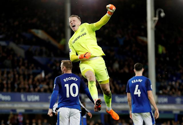 "Soccer Football - Premier League - Everton v Newcastle United - Goodison Park, Liverpool, Britain - April 23, 2018 Everton's Jordan Pickford celebrates after the match Action Images via Reuters/Lee Smith EDITORIAL USE ONLY. No use with unauthorized audio, video, data, fixture lists, club/league logos or ""live"" services. Online in-match use limited to 75 images, no video emulation. No use in betting, games or single club/league/player publications. Please contact your account representative for further details. TPX IMAGES OF THE DAY"