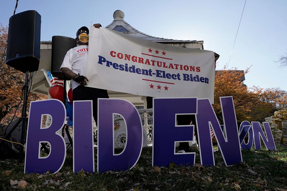Joe Biden supporters in Milwaukee react to the announcement on Nov. 7 that Biden defeated Trump in the presidential election. (Photo: AP Photo/Morry Gash)