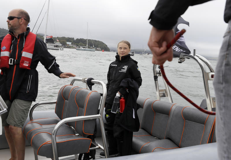 Climate change activist Greta Thunberg waits on a dinghy to board the Malizia II boat in Plymouth, England, Wednesday, Aug. 14, 2019. The 16-year-old climate change activist who has inspired student protests around the world will leave Plymouth, England, bound for New York in a high-tech but low-comfort sailboat.(AP Photo/Kirsty Wigglesworth, pool)