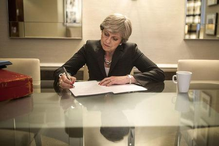 British Prime Minister Theresa May is pictured in her hotel room as she prepares her conference speech that she will deliver to her party's annual conference, tomorrow, in Manchester Central conference center, in Manchester, Britain, October 3, 2017. REUTERS/Christopher Furlong/ Pool