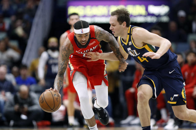 New Orleans Pelicans forward Brandon Ingram, left, is defended by Utah Jazz forward Bojan Bogdanovic, right, in the first half of an NBA basketball game in New Orleans, Monday, Jan. 6, 2020. (AP Photo/Tyler Kaufman)