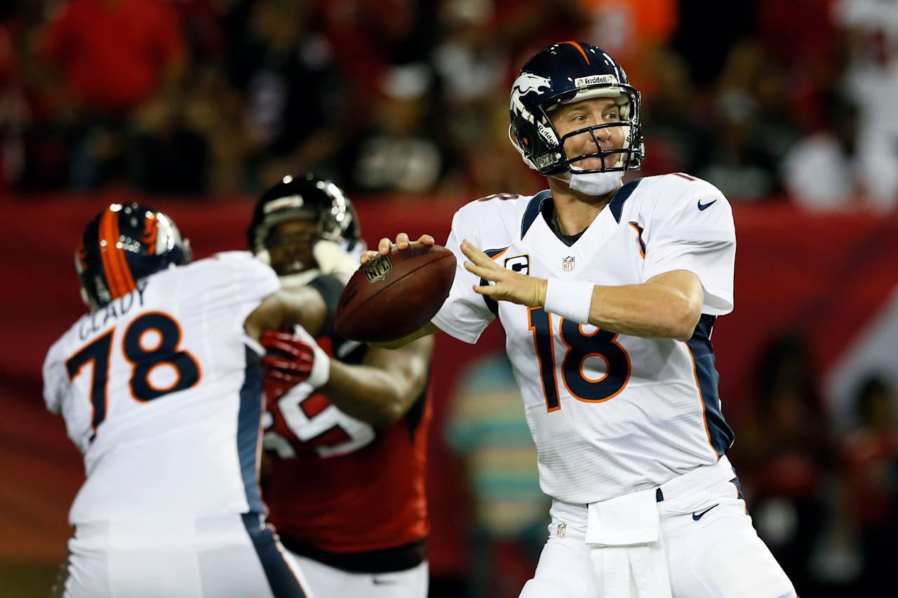 ATLANTA, GA - SEPTEMBER 17:  Quarterback Peyton Manning #18 of the Denver Broncos looks turnover throw the ball against the Atlanta Falcons during their game at the Georgia Dome on September 17, 2012 in Atlanta, Georgia.  (Photo by Kevin C. Cox/Getty Images)