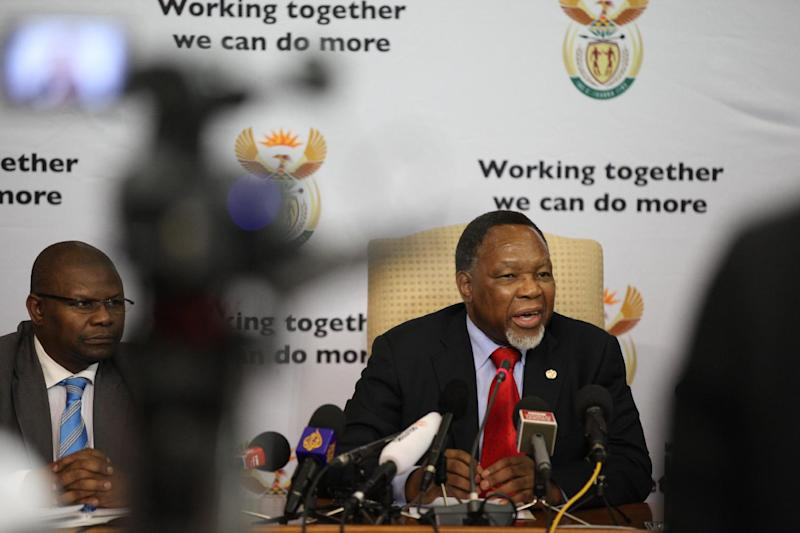 "South Africa's Deputy President Kgalema Motlanthe, right, speaks to foreign journalists at the Union Buildings in Pretoria, South Africa, on Friday, Nov. 30, 2012. Motlanthe says he is ""agonizing"" over whether he would accept leading the governing African National Congress if he's chosen during the party's convention next month over President Jacob Zuma. Some local ANC groups have nominated Motlanthe to take over leadership of the ANC. Typically, whoever leads the ANC becomes the party's presidential candidate. Elections are slated for 2014. (AP Photo/Jon Gambrell)"