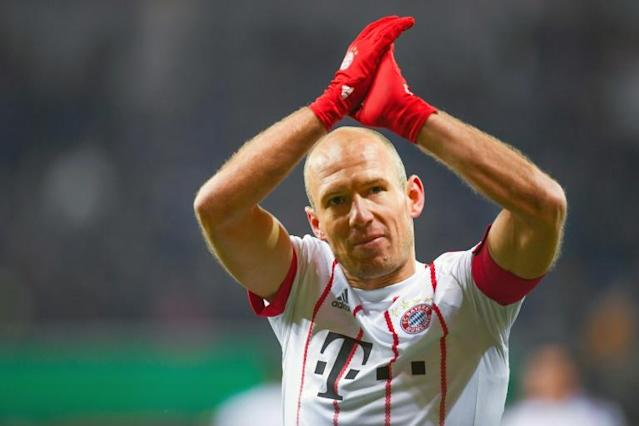 Bayern Munich's Dutch midfielder Arjen Robben cheers at the end of the German football Cup DFB Pokal quarter-final match SC Paderborn versus Bayern Munich (AFP Photo/Patrik STOLLARZ)