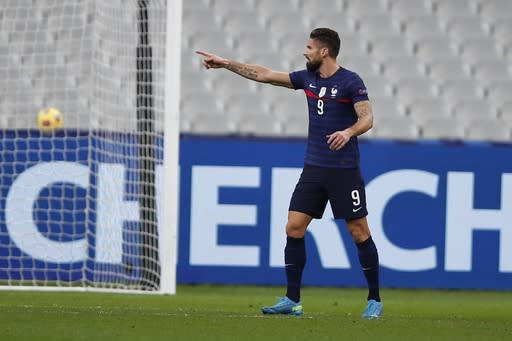 France's Olivier Giroud celebrates after scoring his side's first goal during the UEFA Nations League soccer match between France and Sweden at the Stade de France stadium in Saint-Denis, northern Paris, Tuesday, Nov. 17, 2020. (AP Photo/Francois Mori)