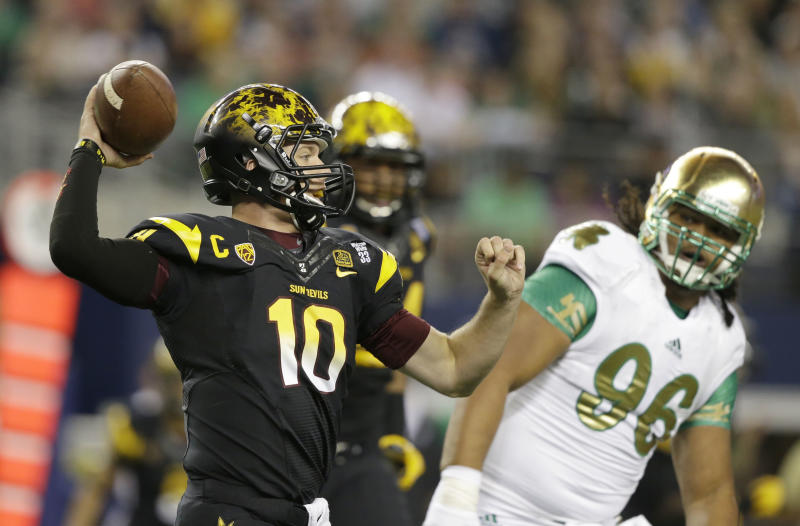 Arizona State quarterback Taylor Kelly (10) passes as Notre Dame defensive lineman Kona Schwenke (96) watches during the first half of an NCAA college football game Saturday, Oct. 5, 2013, in Arlington, Texas. (AP Photo/LM Otero)