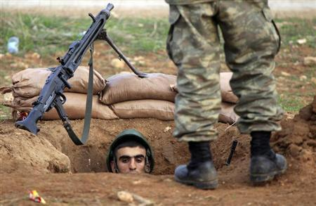 A Turkish soldier takes up position near the border to Syria in the Turkish border town of Ceylanpinar