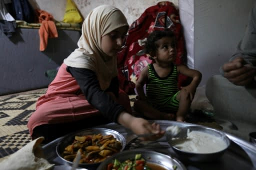 Umm Samer's family, displaced from Eastern Ghouta, gather to break their fast at their home in Maaret Masrin