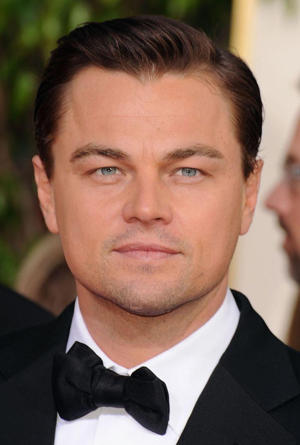 <p>Leonardo DiCaprio has been serving up serious hair envy since starring as Jack Dawson in <em>Titanic—</em>but his clean cut side part is by far one of his fan's favorites. </p>