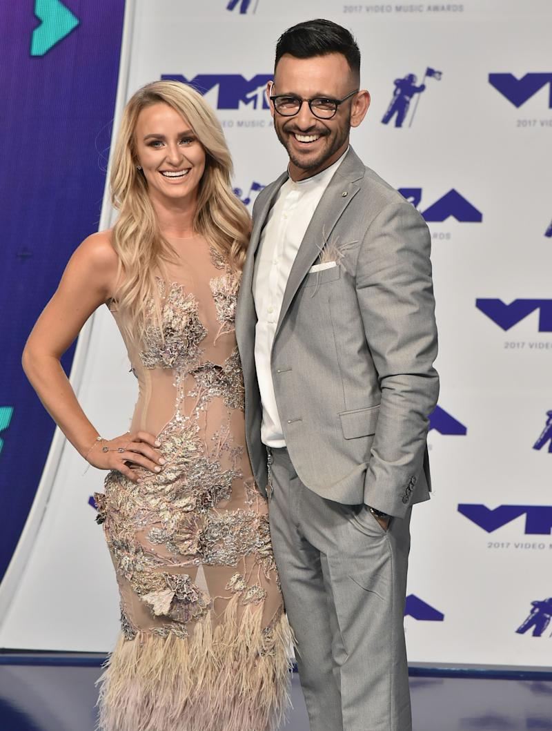Leah Messer looks dazzling in a see-through dress with silver designs and fur beside ex-husband Jeremy, who is dressed in grey suit and pant to match