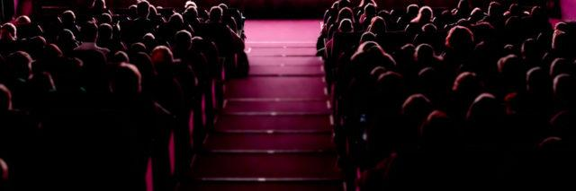 People in theatre audience.