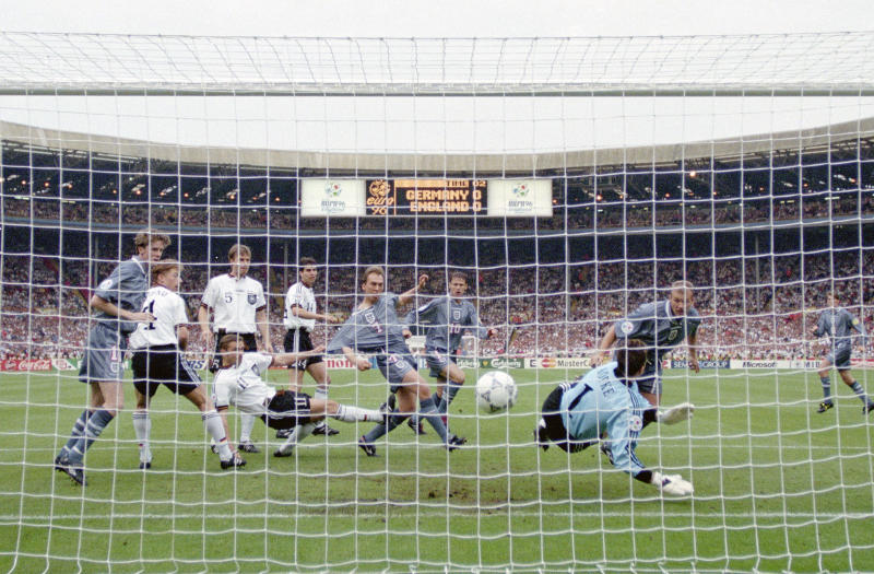 Alan Shearer (back right) gave England the lead with his header in the Euro 96 semifinal against Germany. (Photo by Ross Kinnaird/Allsport/Getty Images/Hulton Archive)